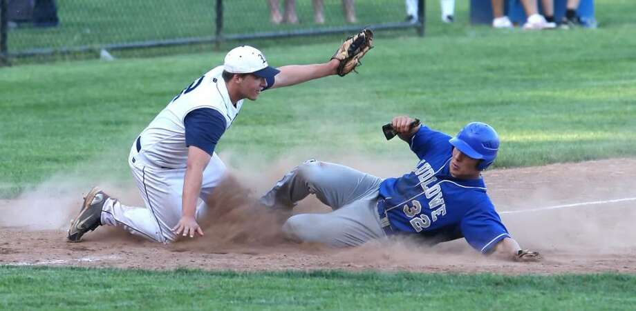 Fairfield Ludlowe's Tom Nagy steals third base in the Falcons' 12-7 win over Wilton in the FCIAC quarterfinals on Tuesday at Wilton High School. Photo: Todd Kalif, Todd Kalif For The Fairfield Citizen