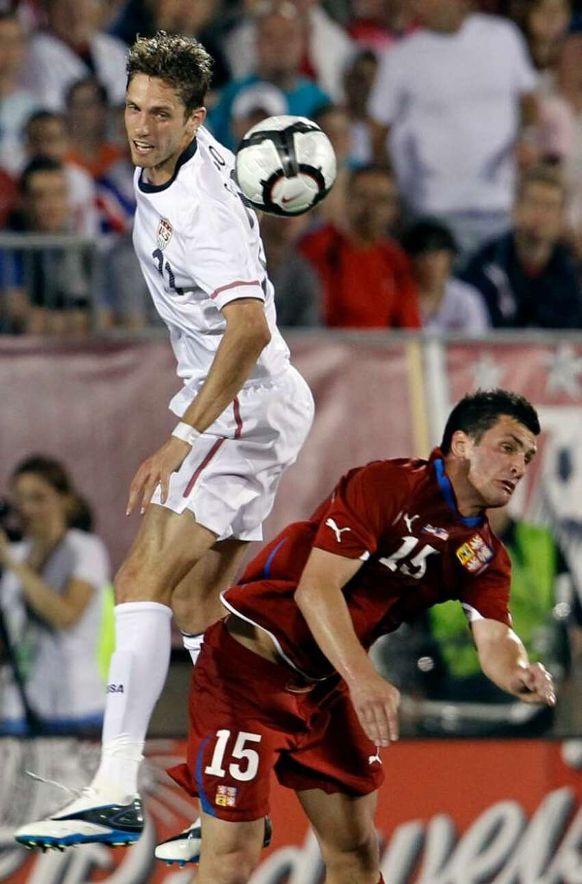 United States' Clarence Goodsen, left, heads the ball against Czech Republic's Martin Fenin (15) during the first half of an international friendly soccer match in East Hartford, Conn., Tuesday, May 25, 2010. The Czech Republic won 4-2.