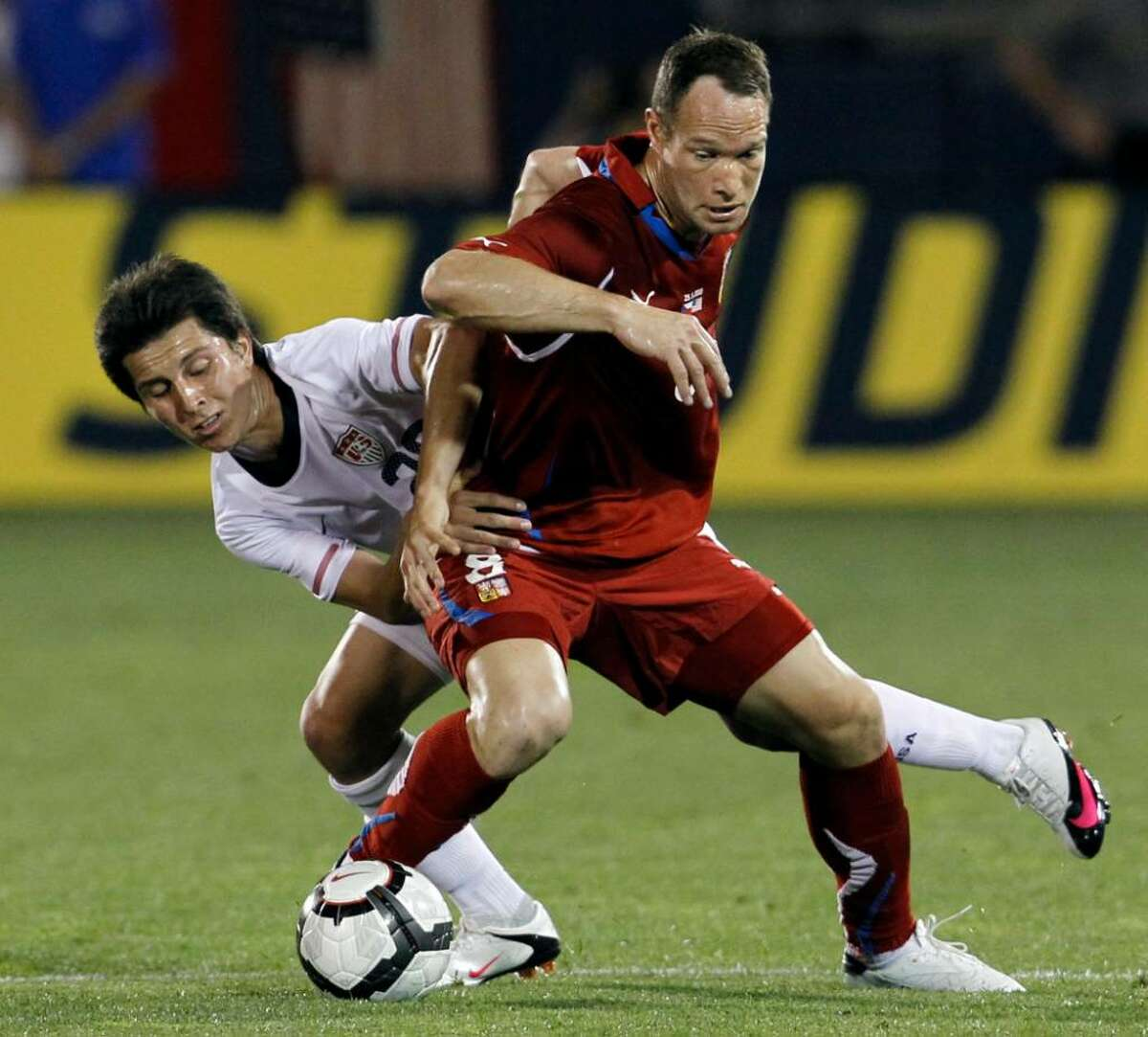United States' Jose Torres, left, attempts to hold Czech Republic's Jan Polak (8) from controlling the ball during the first half of an international friendly soccer match in East Hartford, Conn., Tuesday, May 25, 2010. Czech Republic won 4-2.
