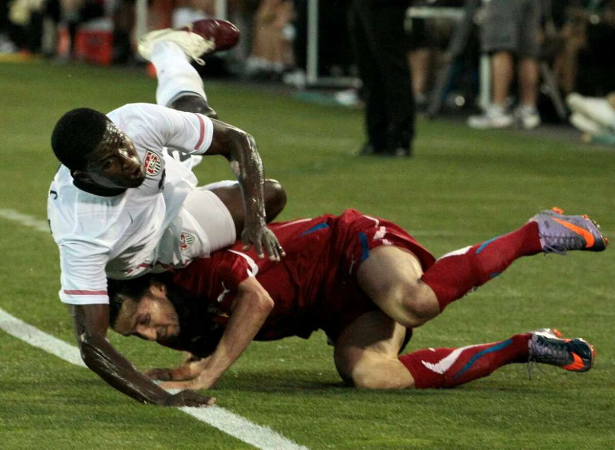United States' Edson Buddle falls over Czech Republic's Tomas Sivok after chasing the ball during the first half of an international friendly soccer match in East Hartford, Conn., Tuesday, May 25, 2010. The Czech Republic won 4-2.