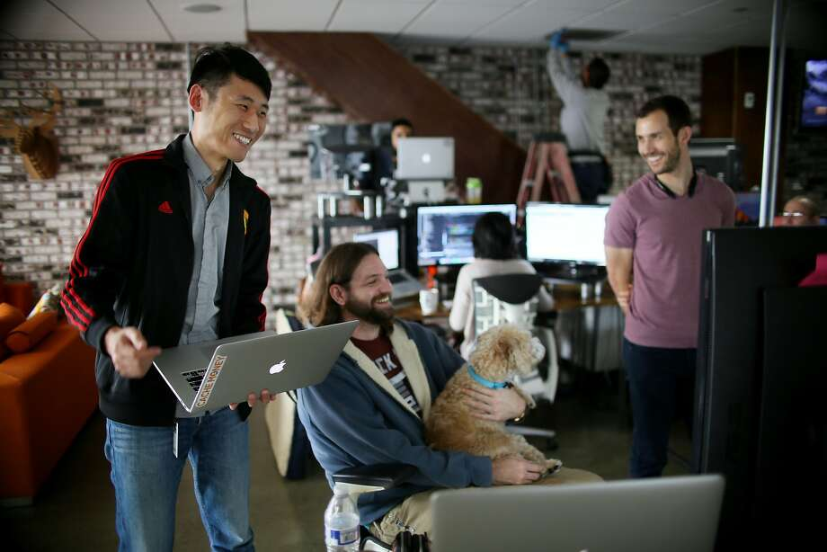 Kan Wang and engineer at Zeeto and an H-1B Visa holder, looks over a project with workmate Her Johnson at their offices in San Diego, CA on Friday, January 13, 2017.  The Trump administration says it plans on changing the nation's immigration process and will likely look at reforming the H-1B visa program. Many tech firms hire people through this program and some companies and entrepreneurs are concerned about whether changes could impact their hiring process.Photo by Sandy Huffaker/Special to The Chronicle) Photo: Sandy Huffaker, Special To The Chronicle