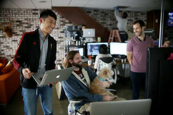 Kan Wang and engineer at Zeeto and an H-1B Visa holder, looks over a project with workmate Her Johnson at their offices in San Diego, CA on Friday, January 13, 2017.  The Trump administration says it plans on changing the nation's immigration process and will likely look at reforming the H-1B visa program. Many tech firms hire people through this program and some companies and entrepreneurs are concerned about whether changes could impact their hiring process.Photo by Sandy Huffaker/Special to The Chronicle)