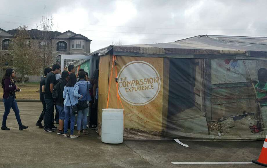 A group of students from George I Sanchez Charter High School in Houston file into the Compassion Experience at Faith Family Baptist Church in Kingwood Friday, Jan. 13. Photo: Melanie Feuk