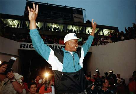 "12/02/1989 - Andre Ware greets the crowd at Rice Stadium shortly after hearing the announcement that he had won the Heisman Trophy. Ware climbed an equipment cart and proclaimed to the crowd: ""We've brought the Heisman Trophy to Houston, Texas. And to the University of Houston!"""