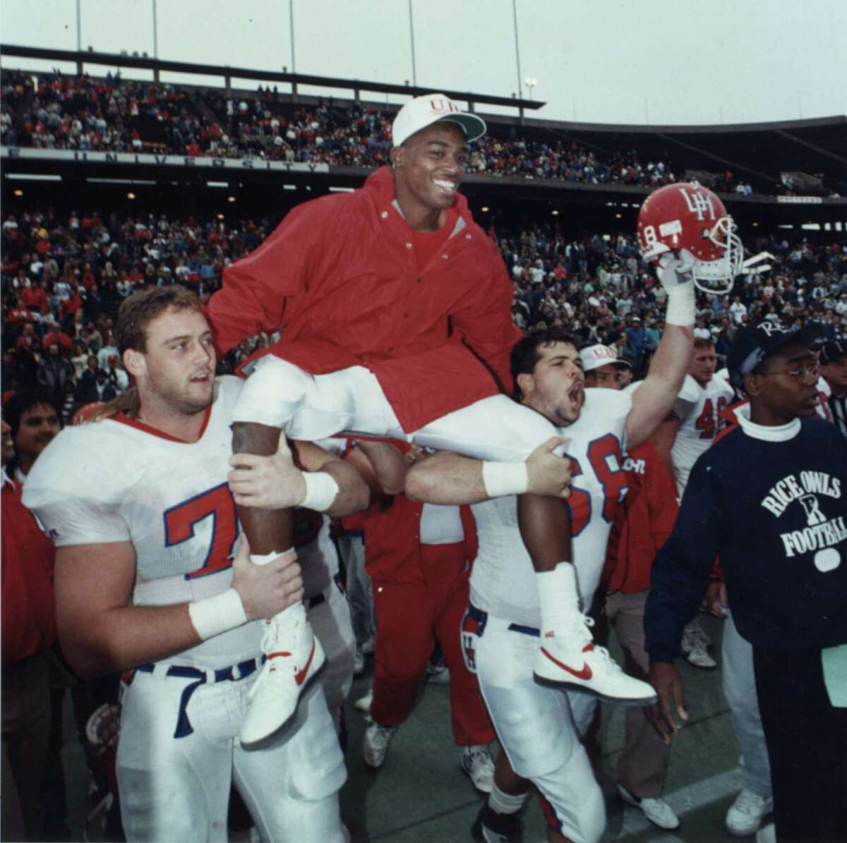 12/02/1989 - Andre Ware is carried on the shoulders of his teammates off the field after Houston's final game of the 1989 season played at Rice Stadium against the Rice Owls.