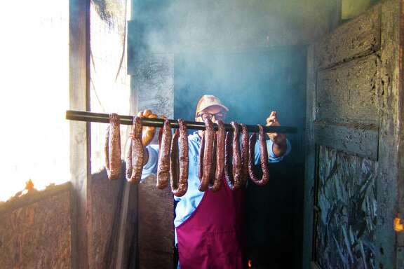 Arthur Yarbough smokes his links, based on his own recipe, in a custom-made smoker.
