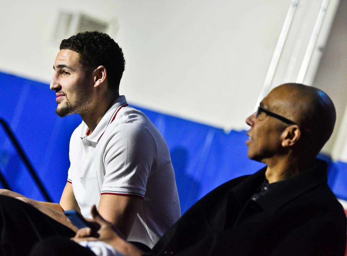 Klay Thompson left, and his father Mychal Thompson, right, during the retirement ceremony for Klay's jersey at Santa Margarita Catholic High School Friday. Golden State Warriors NBA player Klay Thompson has his jersey retired at his high school alma mater, Santa Margarita Catholic High School on Friday, Jan. 13, 2017 in Ranch Santa Margarita,Calif.
