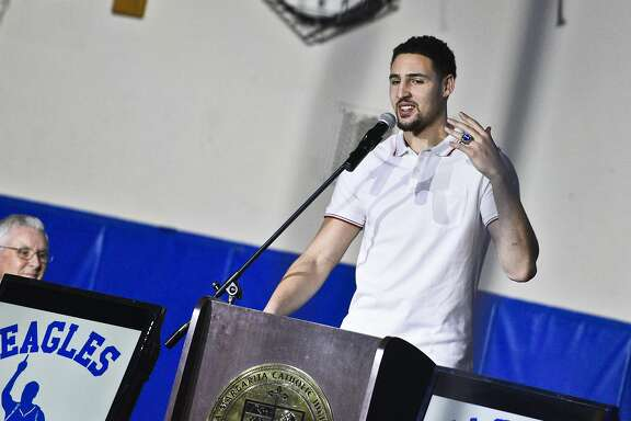 Klay Thompson gives brief remarks during the retirement ceremony for his jersey at Santa Margarita Catholic High School on Friday.  Golden State Warriors NBA player Klay Thompson has his jersey retired at his high school alma mater, Santa Margarita Catholic High School on Friday, Jan. 13, 2017 in Ranch Santa Margarita,Calif.