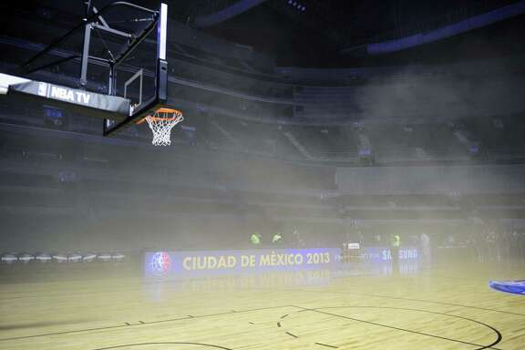 General view inside Mexico City Arena where players were evacuated because of smoke before the game between Minnesota Timberwolves and San Antonio Spurs in Mexico City on Dec. 4, 2013. A transformer burned and spread smoke on the court before the game.