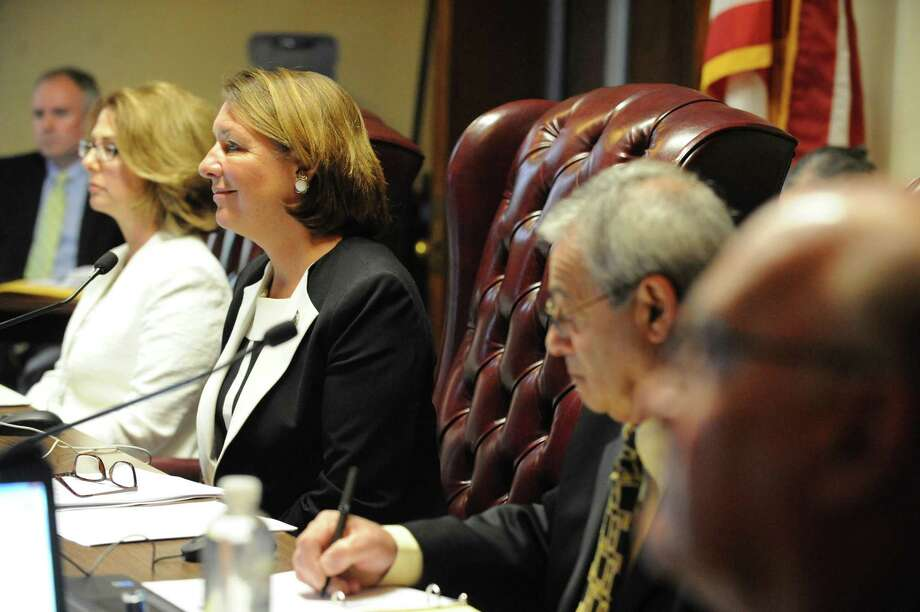 "Saratoga Springs commissioners, including Finance Commissioner Michelle Madigan (at left in white), Mayor Joanne Yepsen, and Commissioner Anthony ""Skip"" Scirocco at Saratoga Springs City Hall. (Times Union Archive) Photo: Michael P. Farrell / 40036865A"