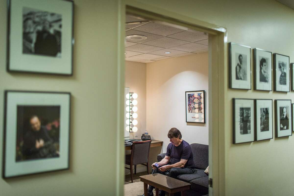 """David Newman sits in his dressing room before he conducts the San Francisco Symphony as it screens the Marlon Brando classic """"On The Waterfront,"""" performing Leonard Bernstein's Oscar-winning soundtrack live, Saturday, Jan. 7, 2017 in San Francisco, CA."""