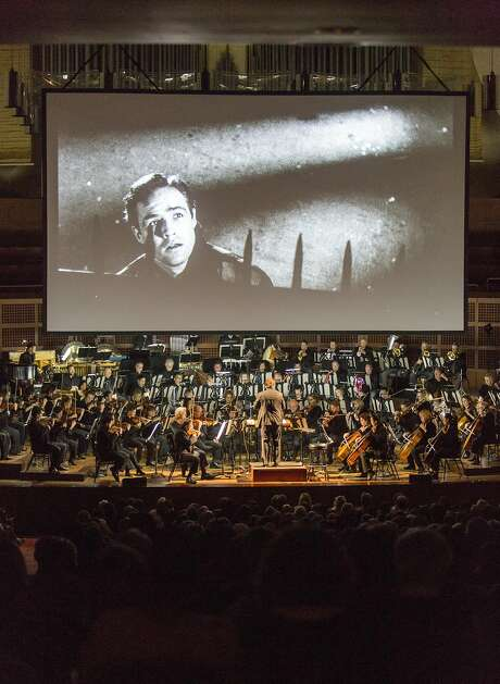 """David Newman leads the S.F. Symphony through Leonard Bernstein's score to """"On the Waterfront"""" last Saturday as the film plays. Photo: Eric Kayne, Special To The Chronicle"""