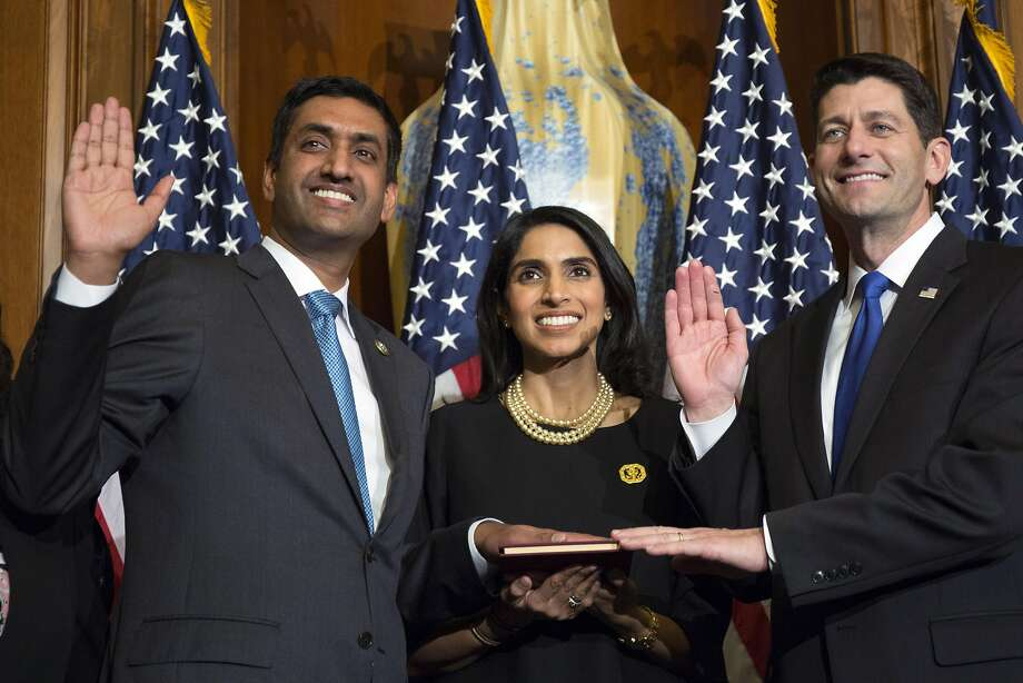 Ro Khanna and his wife, Ritu, are the center of a mock swear- ing in presided over by House Speaker Paul Ryan on Jan. 3. Photo: Zach Gibson, Associated Press