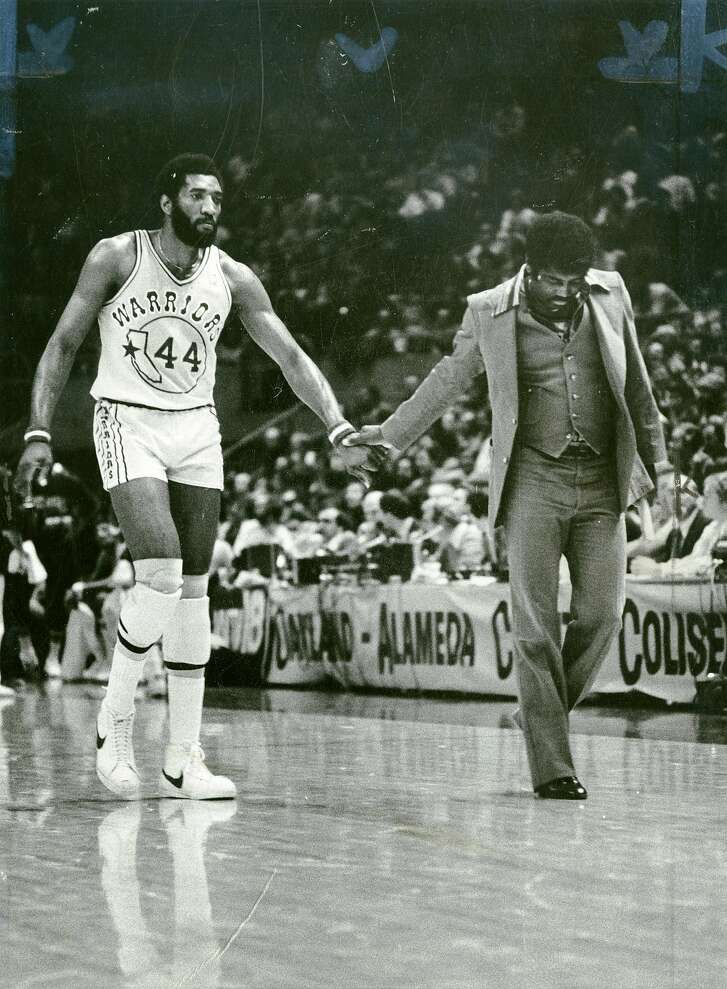 Golden State Warriors Clifford Ray and Al Attles walk off the floor at halftime. Feb. 4, 1978.