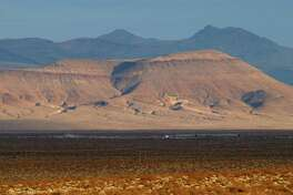 Early morning light shines on the proposed nuclear waste dump site of Yucca Mountain in 2002 at Nellis Air Force Base, located approximately 90 miles north of Las Vegas, Nev. The retirement of former Senate Majority Leader Harry Reid paves the way for a renewed push to make this a permanent waste site.
