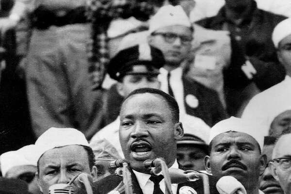 "Martin Luther King, Jr. delivers his famous speech on the steps of the Lincoln Memorial in Washington on August 28, 1963. King told the crowd of 200,000 people, ""I have a dream that this nation will rise up and live out the true meaning of its creed, 'We hold these truths to be self evident: that all men are created equal'."""