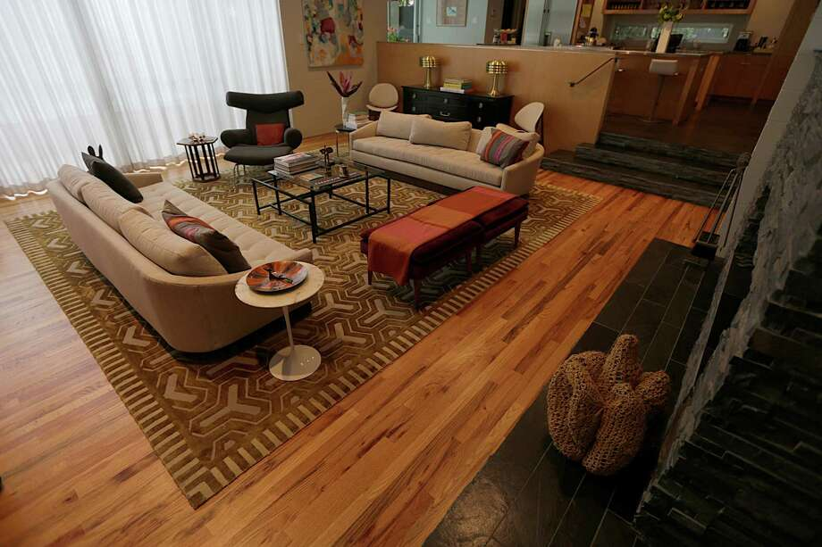 Lynn Goode's living room features vintage sofas by Directional Furniture, a Saarinen table by Knoll and Ox chair by Hans Wegner. Photo: James Nielsen, Staff / © 2017  Houston Chronicle