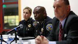 Police chief Tony Chaplin (center) and commander Greg McEachern answer questions from the public at the town hall meeting on January 12, 2017 to update the public about an officer involved shooting of an unarmed man that occurred on January 6th on the 500 block of Capitol Avenue in San Francisco, Calif.