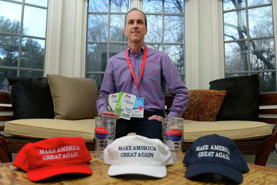 Jim Campbell poses with a few of his Trump hats and other memorabilia at his home in Westport, Conn., on Friday Jan. 13, 2017. Campbell, who was a Connecticut delegate at the Republican National Convention will be attending the inauguration of Donald Trump on Jan. 20th. Photo: Christian Abraham / Hearst Connecticut Media / Connecticut Post