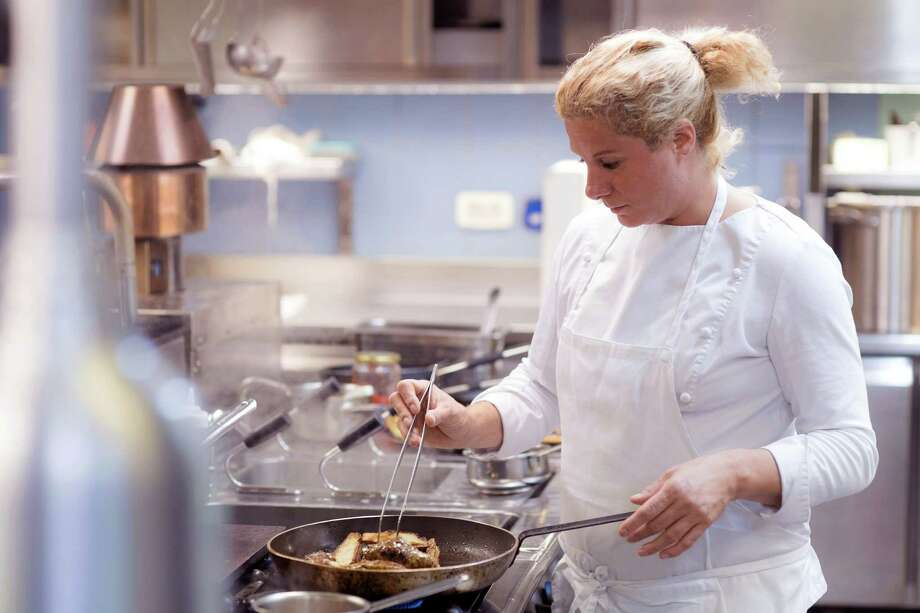 "This undated photo provided by the Slovenia Tourist Board shows chef Ana Ros of Hisa Franko, in the remote village of Kobarid, in the western part of Slovenia. Ros, who starred last year in an episode of the ""Chef's Table"" Netflix series, heads the kitchen and her husband Valter Kramar is the resident cheese and wine expert at the inn and restaurant on the small farm he inherited from his father. Ros' cooking skills are largely self-taught, though she was mentored by culinary luminaries to become a master chef of a surprising cuisine. ""I found my own way of creating that's in some way freer,"" she says, adding that the only thing she'd hate to hear from guests ""would be that the dinner was boring.""(Slovenia Tourist Board via AP) Photo: HONS / Slovenia Tourist Board"