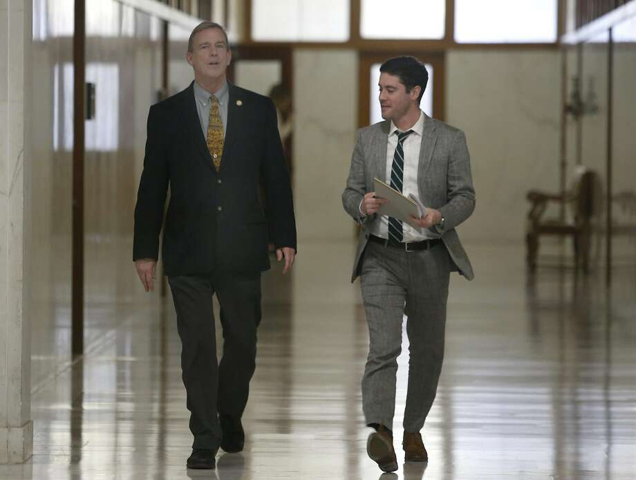New Supervisor Jeff Sheehy (left) walks with Ted Conrad, an interim assistant, to a meeting on health care in San Francisco City Hall. Photo: Paul Chinn, The Chronicle