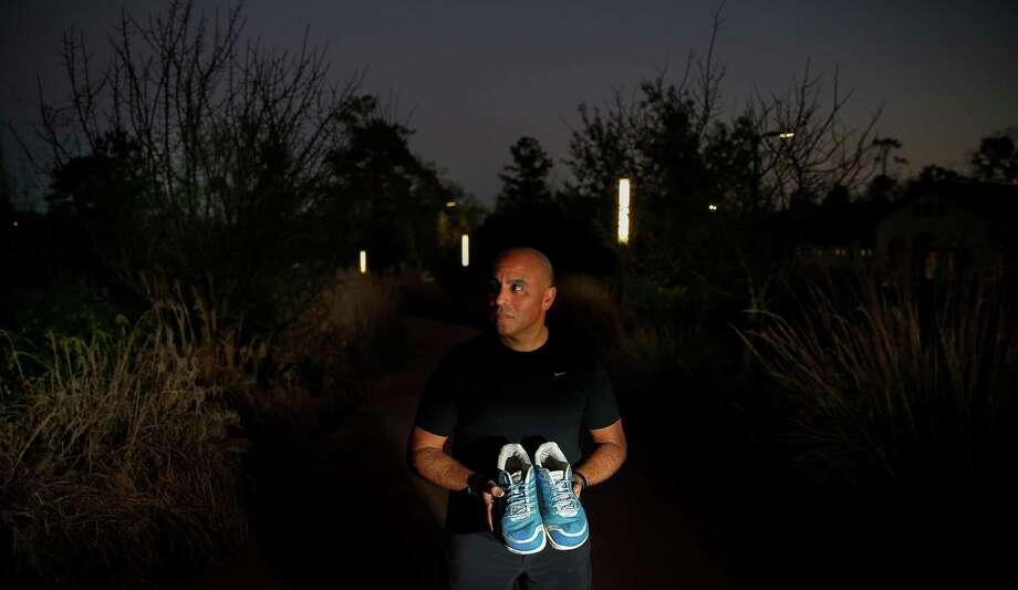 Samuel Lopez, a member of Catapult, a non-profit that helps physically challenged athletes train and race in competitions, holds the running shoes of Robert Peck Thursday, Jan. 12, 2017 in Houston. Peck was a 22-year-old blind man who died from injuries suffered in a New Year's Day hit-and-run. Lopez was planning to run the half marathon side-by-side with Peck, but will now run it alone, carrying Peck's shoes. ( Michael Ciaglo / Houston Chronicle ) Photo: Michael Ciaglo, Staff / © 2016  Houston Chronicle
