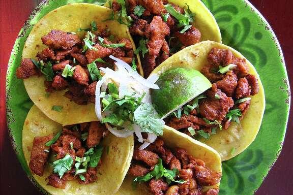 Al pastor mini-tacos from Sabor Cocina Mexicana on Bandera Road.