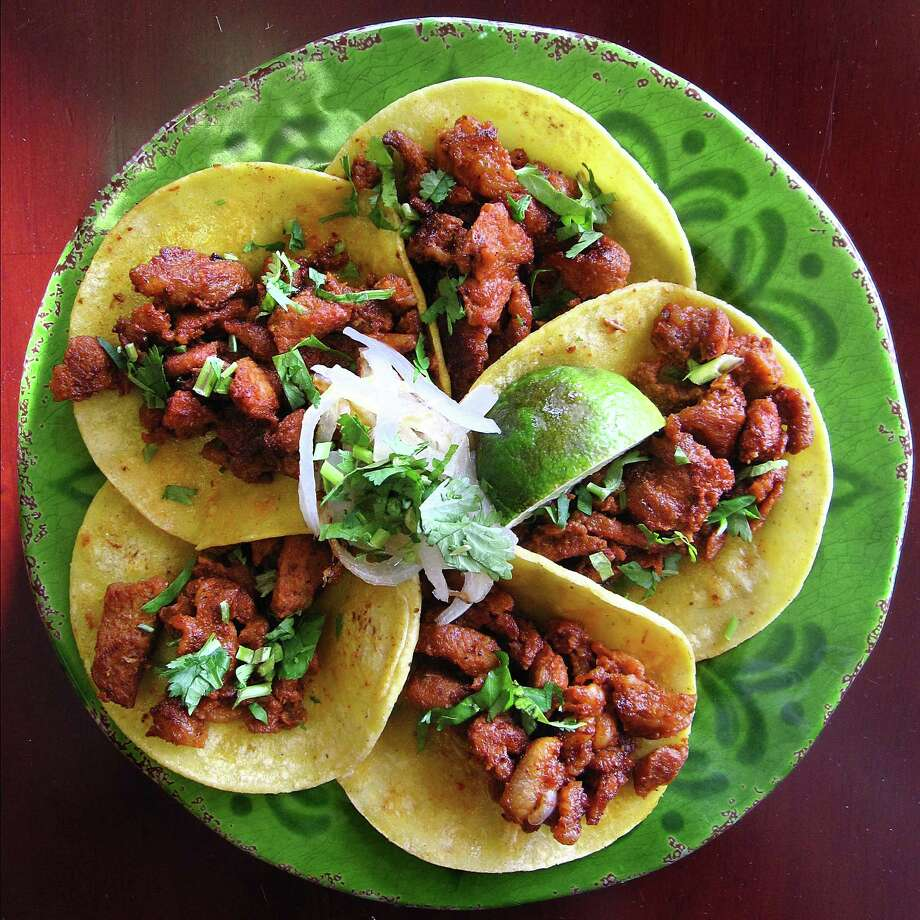 Al pastor mini-tacos from Sabor Cocina Mexicana on Bandera Road Photo: Mike Sutter /San Antonio Express-News