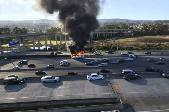 An RV fire engulfed in flames shot smoke into the sky Friday afternoon on southbound Highway 101 near the San Francisco International Airport.