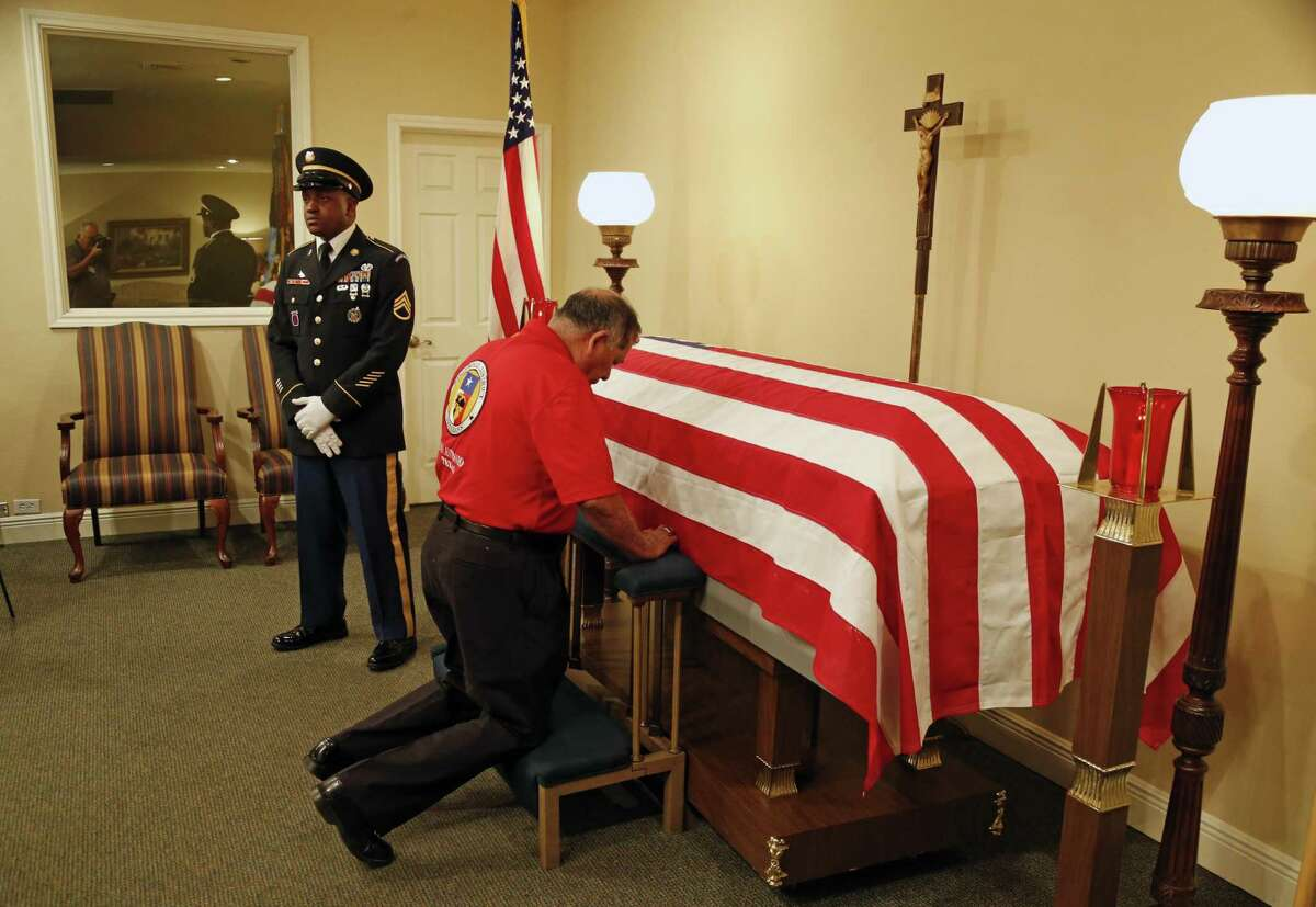 Family,veterans and friends paid their respect as the family of Luis Patlan Torres, a soldier lost in Korea and MIA/POW for 66 years, will receive his Purple Heart from representatives of his unit. In this ceremony, a final salute will be given as well as a rosary. Photos taken on Thursday, January 12, 2017 at Roy Acker Funeral Home.