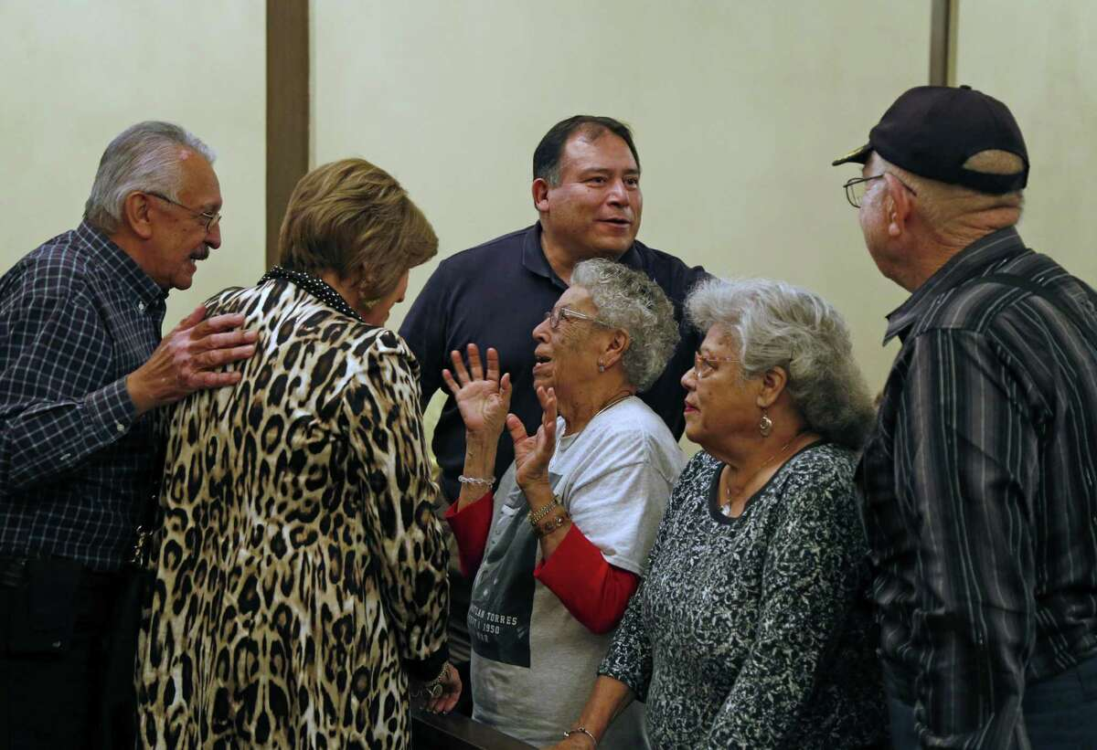 Guadalupe T Mendoza(sister to Luis Patlan Torres),center, is greeted as the family of Luis Patlan Torres, a soldier lost in Korea and MIA/POW for 66 years, will receive his Purple Heart from representatives of his unit. In this ceremony, a final salute will be given as well as a rosary. Photos taken on Thursday, January 12, 2017 at Roy Acker Funeral Home.