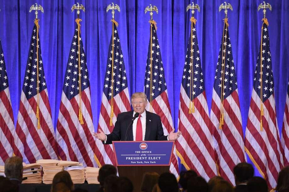 TOPSHOT - US President-elect Donald Trump gives a press conference January 11, 2017 in New York. Donald Trump is holding his first news conference in nearly six months Wednesday, amid explosive allegations over his ties to Russia, a little more than a week before his inauguration. / AFP PHOTO / Don EMMERTDON EMMERT/AFP/Getty Images Photo: DON EMMERT, Staff / AFP or licensors