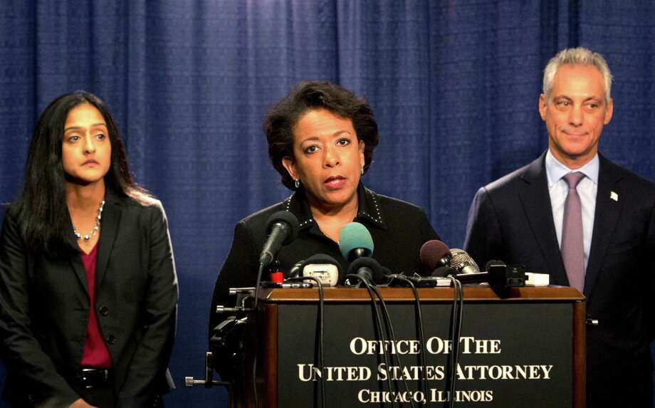 Attorney General Loretta Lynch speaks during a news conference accompanied by Principal Deputy Assistant Attorney General Vanita Gupta, left, and Chicago Mayor Rahm Emanuel Friday, Jan. 13, 2017, in Chicago. The U.S. Justice Department issued a scathing report on civil rights abuses by Chicago's police department over the years. The report released Friday alleges that institutional Chicago Police Department problems have led to serious civil rights violations, including racial bias and a tendency to use excessive force. (AP Photo/Teresa Crawford) Photo: Teresa Crawford, STF / Copyright 2017 The Associated Press. All rights reserved.