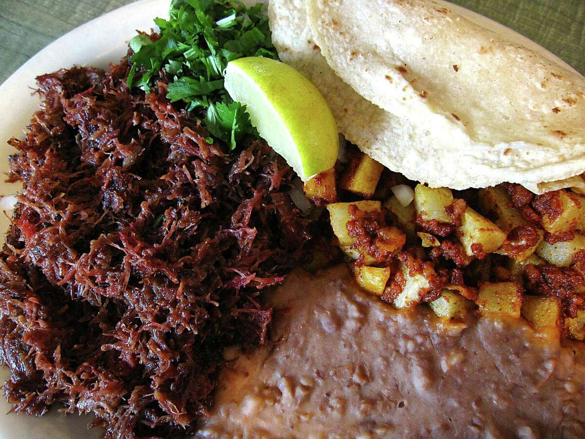 The VIP barbacoa plate with beans, papas con chorizo and handmade corn tortillas from El Milagrito Cafe.