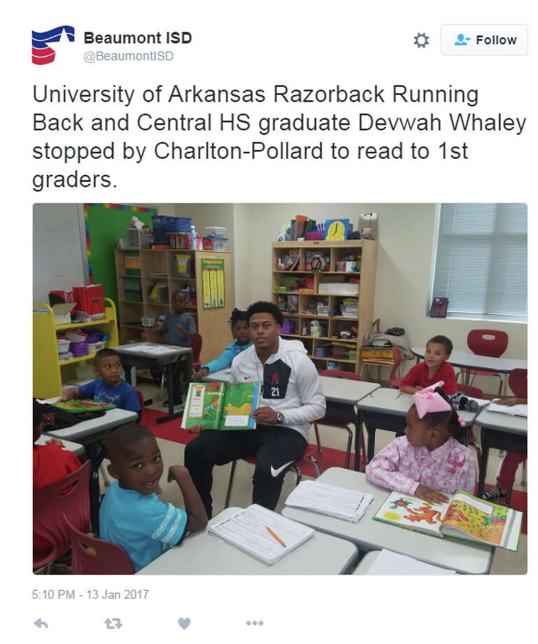 Former Central running back Devwah Whaley, who just finished his freshman season at Arkansas, reads to kids at Charlton-Pollard Elementary School. Photo: Beaumont ISD Twitter