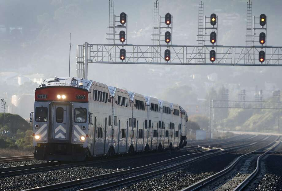 A northbound express train approaches the Bayshore Caltrain station in Brisbane. Efforts to electrify Caltrain engines began 20 years ago. Photo: Paul Chinn, The Chronicle