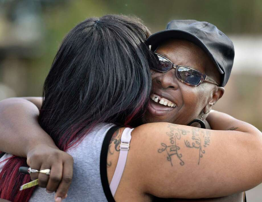Velma Aiken, the paternal grandmother of Kamiyah Mobley, who was kidnapped as an infant 18 years ago, gets a congratulatory hug from a family member after Mobley was found safe Friday, Jan. 13, 2017, in Jacksonville, Fla.  (Will Dickey /The Florida Times-Union via AP) Photo: Will Dickey, MBI / Will Dickey/Florida Times-Union