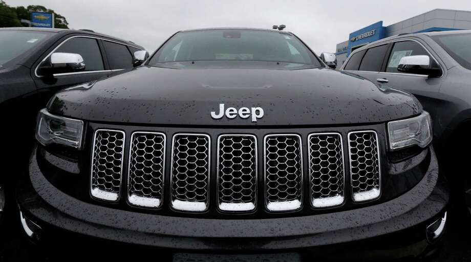 """FILE - This Oct. 1, 2014, file photo, shows the hood of a Jeep Grand Cherokee at Bill DeLuca's dealerships in Haverhill, Mass. On Thursday, Jan. 12, 2017, the U.S. government alleged that Fiat Chrysler Automobiles failed to disclose that software in some of its pickups and SUVs with diesel engines allows them to emit more pollution than allowed under the Clean Air Act. The Environmental Protection Agency said in a statement that it issued a """"notice of violation"""" to the company that covers about 104,000 vehicles, including the 2014 through 2016 Jeep Grand Cherokee and Dodge Ram pickups, all with 3-liter diesel engines. (AP Photo/Charles Krupa, File) Photo: Charles Krupa, STF / Copyright 2017 The Associated Press. All rights reserved."""