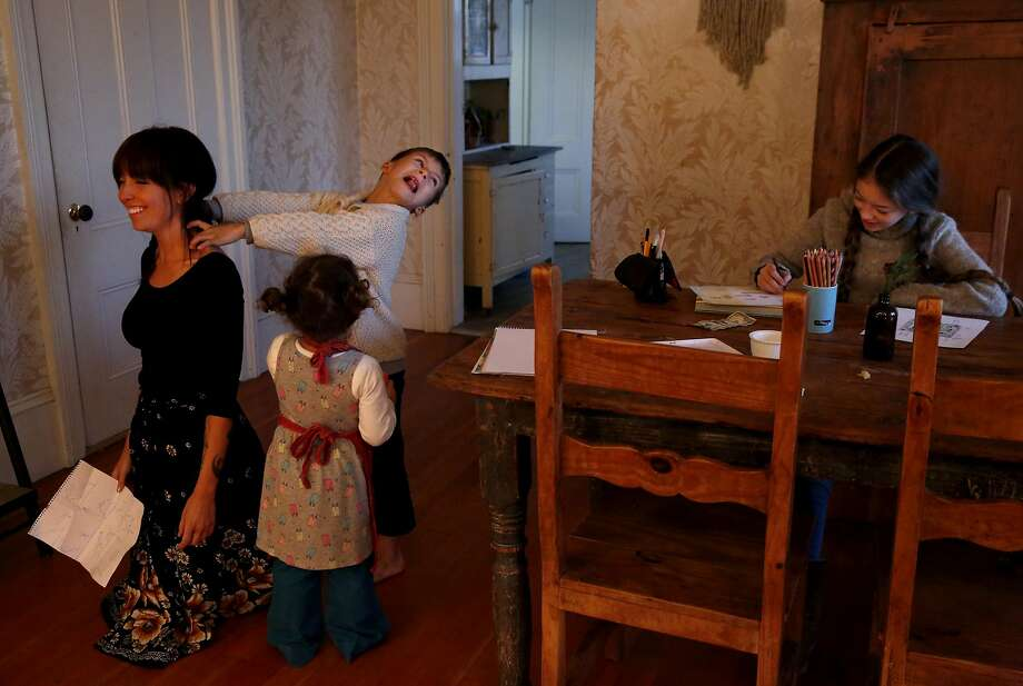 Belle Sweeney plays with her children at their Sebastopol home, a world away from the chaotic Greek refugee camps. Photo: Leah Millis, The Chronicle