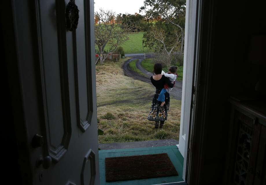 Belle Sweeney walks to the mailbox with two of her children, who she preferred not to name, as dusk falls at her home Jan. 5, 2017 in Sebastopol, Calif. Photo: Leah Millis, The Chronicle