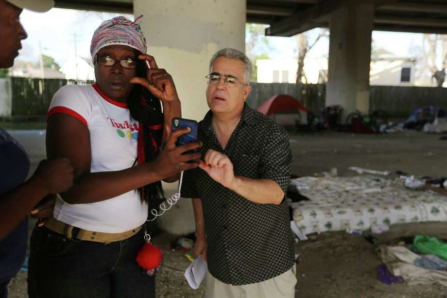 George Ruano looks at a photo a woman thinks may be his missing brother while handing out fliers underneath US 59, Thursday, Jan. 12, 2017, in Houston. Ruano has been searching for his brother, Daniel Almendi, who suffers from schizophrenia, since Daniel was released from the Harris County Psychiatric Center on Nov. 30, 2016. The person in the picture was not Ruano's brother. Photo: Houston Chronicle / © 2017 Houston Chronicle
