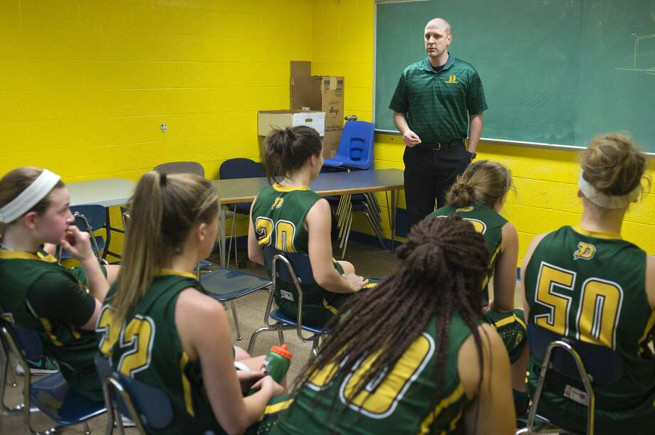 Dow High's head coach Kyle Theisen talks to his team during halftime of the Friday evening game against Midland High. Dow was behind by one at the half but came back to defeat Midland 52-51. Photo: Brittney Lohmiller/Midland Daily News/Brittney Lohmiller