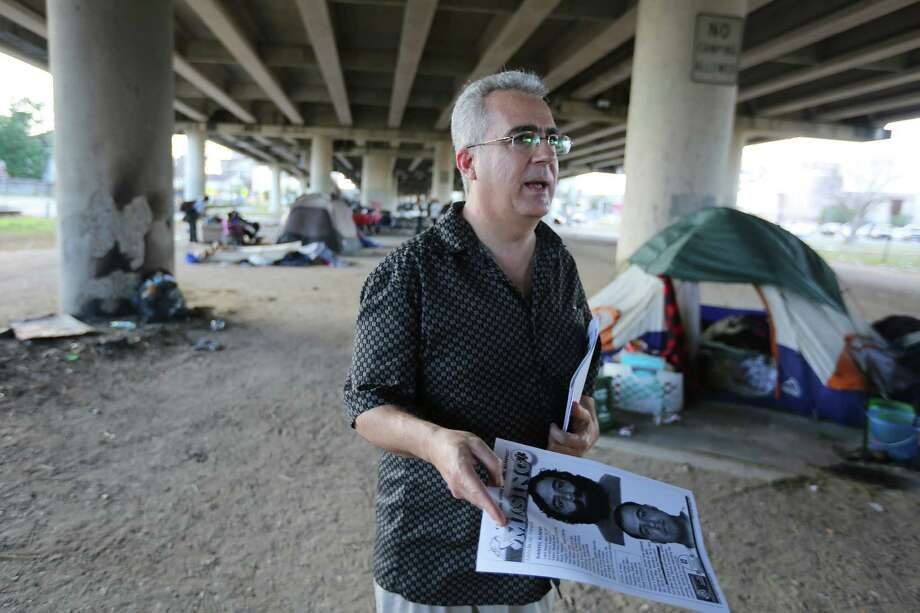 George Ruano hands out fliers including pictures and information about his missing brother underneath US 59 between Caroline and La Branch streets, Thursday, Jan. 12, 2017, in Houston. Ruano has been searching for his brother, Daniel Almendi, who suffers from schizophrenia, since Daniel was released from the Harris County Psychiatric Center on Nov. 30, 2016. Photo: Houston Chronicle / © 2017 Houston Chronicle