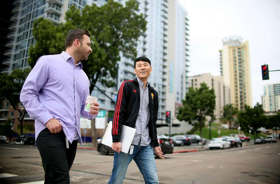 Kan Wang, an engineer at Zeeto and an H-1B visa holder, walks in downtown San Diego with Brian Jones, near their offices on Friday, January 13, 2017. The Trump administration says it plans on changing the nation's immigration process and will likely look at reforming the H-1B visa program. Many tech firms hire people through this program, and some companies and entrepreneurs are concerned about whether changes could impact their hiring process. Photo by Sandy Huffaker/Special to The Chronicle) Photo: Sandy Huffaker, Special To The Chronicle