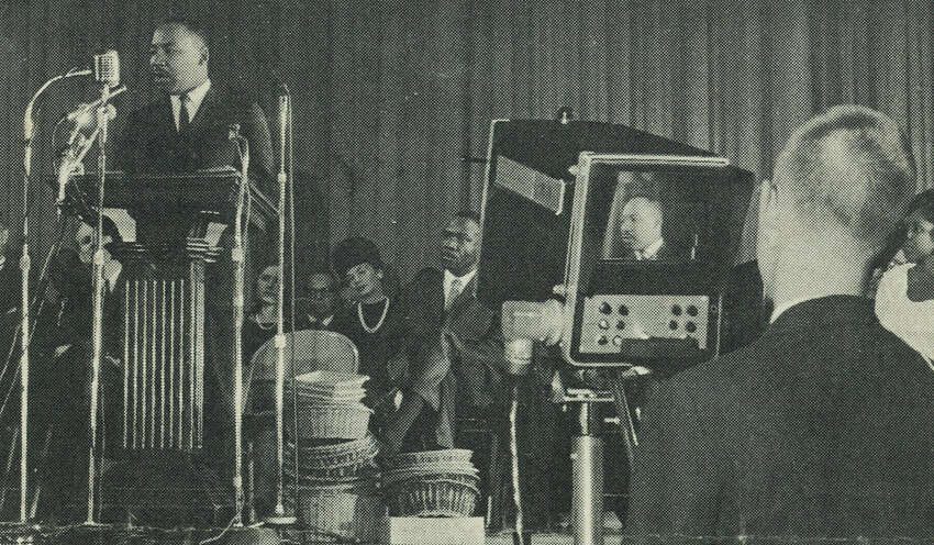 John E. Maher, then a sophomore at Darien High School, films the Rev. Martin Luther King Jr. speaking at Stamford High School on Nov. 30, 1964. Maher says King spoke so forcefully that when he shifted to the left and reached around to adjust the zoom lens in the front of the camera, he could feel King's breath on his hand.