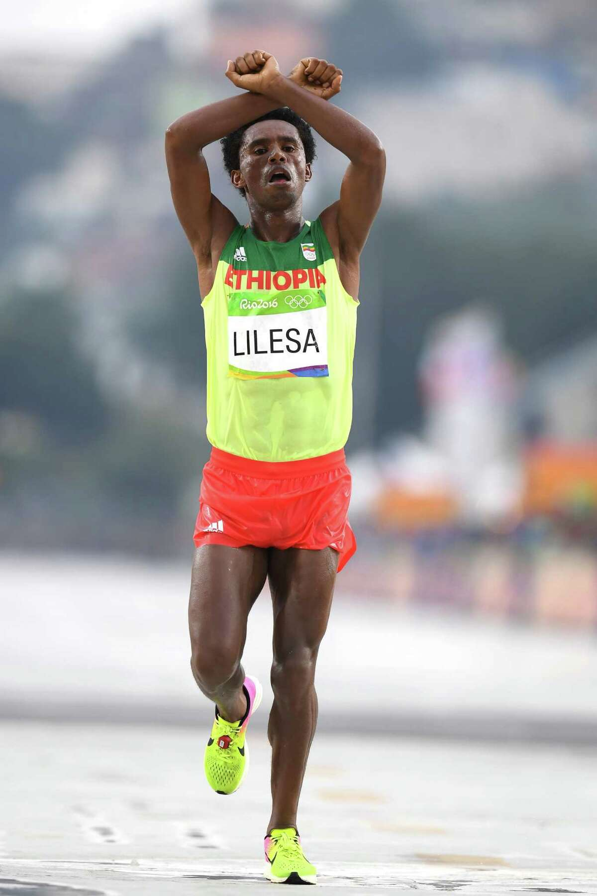 It was this sign while winning silver in the marathon at the Rio Olympics that got Feyisa Lilesa in hot water with the Ethiopian government.