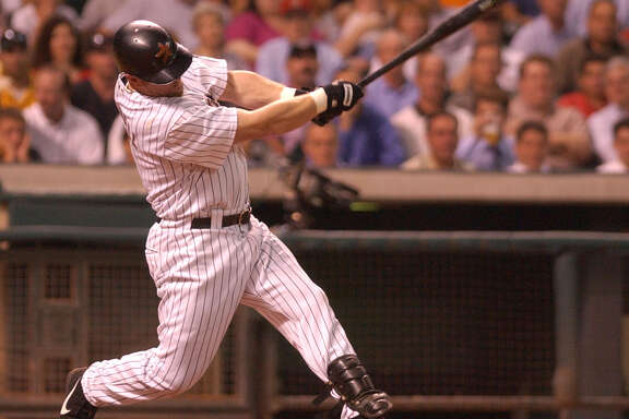 (8/7/02) Jeff BAgwell powers the ball into left field on a triple in the 4th inning, during the Houston Astros-Florida Marlins game at Minute Maid Park, Wednesday evening. (Karen Warren/Houston Chronicle)