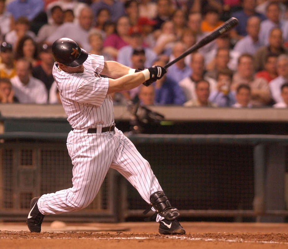 Jeff Bagwell powers the ball into left field on a triple in the 4th inning, during the Houston Astros-Florida Marlins game at Minute Maid Park in 2002. Photo: Karen Warren, STAFF / Houston Chronicle