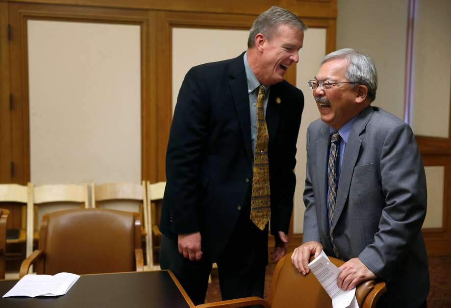 Supervisor Jeff Sheehy laughs Friday with Mayor Ed Lee, who appointed him to the Board of Supervisors. Photo: Paul Chinn, The Chronicle