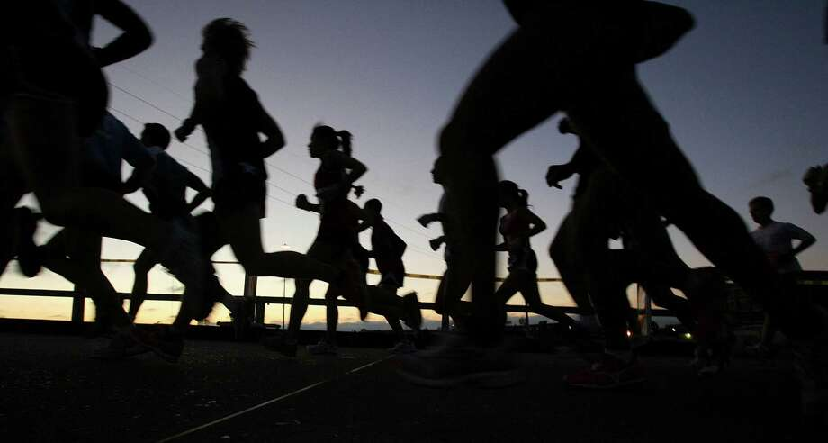 Warm, muggy weather conditions will be less than ideal for Sunday's Chevron Houston Marathon, but that's the hand Mother Nature has dealt runners in this year's event.    Photo by Mayra Beltran Photo: Mayra Beltran, Staff / Houston Chronicle